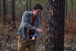 Tyler Mitchell collecting a tree core