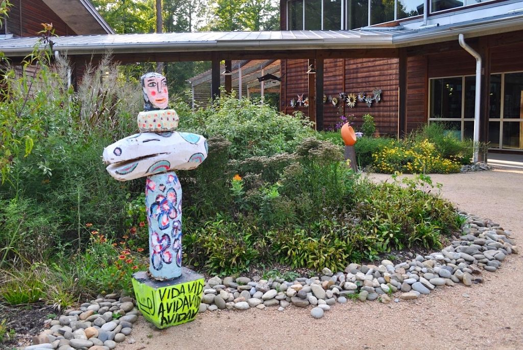 Totem sculpture by Nico Amortegui in the North Carolina Botanical Garden