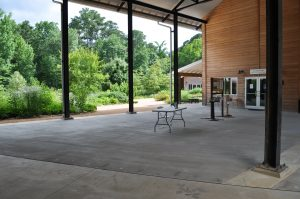 The Sara Waitt Breezeway, a large, covered, paved space with views out onto our Courtyard Gardens.